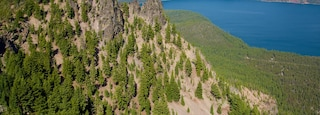Newberry National Volcanic Monument featuring forest scenes and mountains