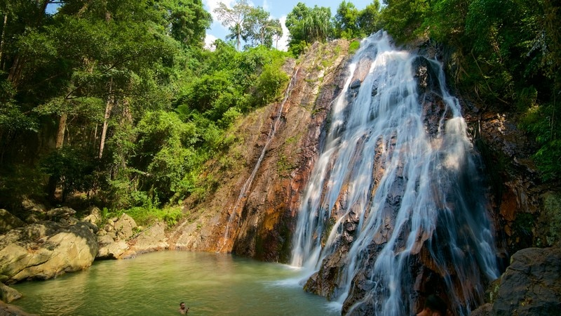 Namuang Waterfall which includes a cascade, forest scenes and a river or creek