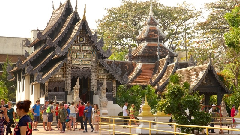 Wat Chedi Luang which includes a temple or place of worship as well as a large group of people