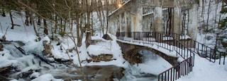 Outaouais showing a river or creek, a bridge and snow