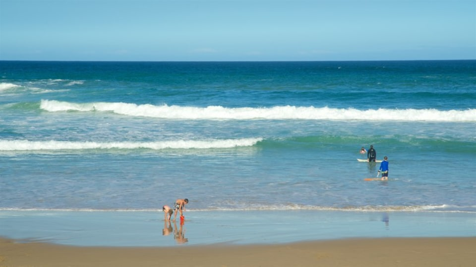 Victoria Bay Beach featuring swimming and a sandy beach as well as children