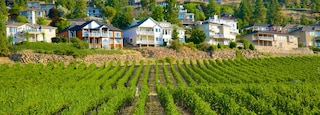 Kelowna which includes a house, farmland and tranquil scenes
