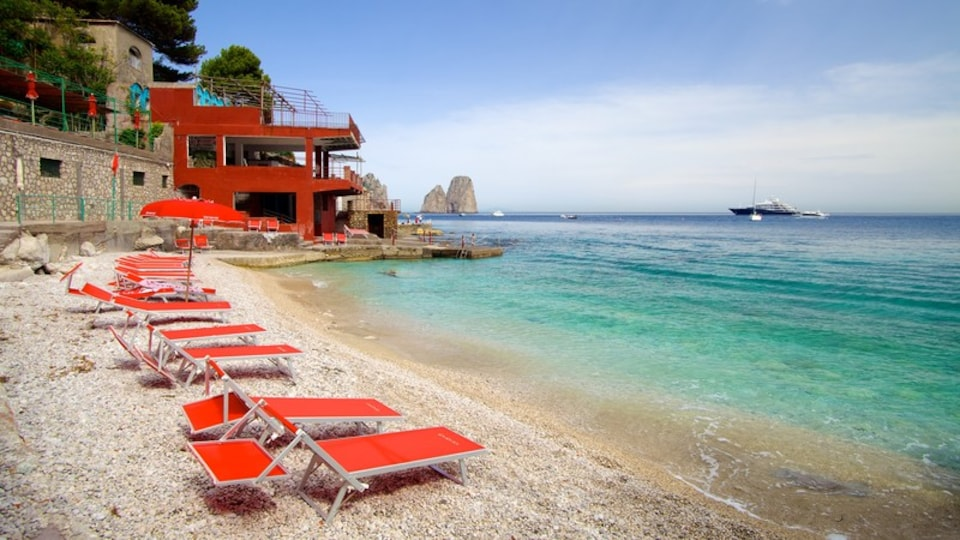 Marina Piccola featuring a luxury hotel or resort and a pebble beach