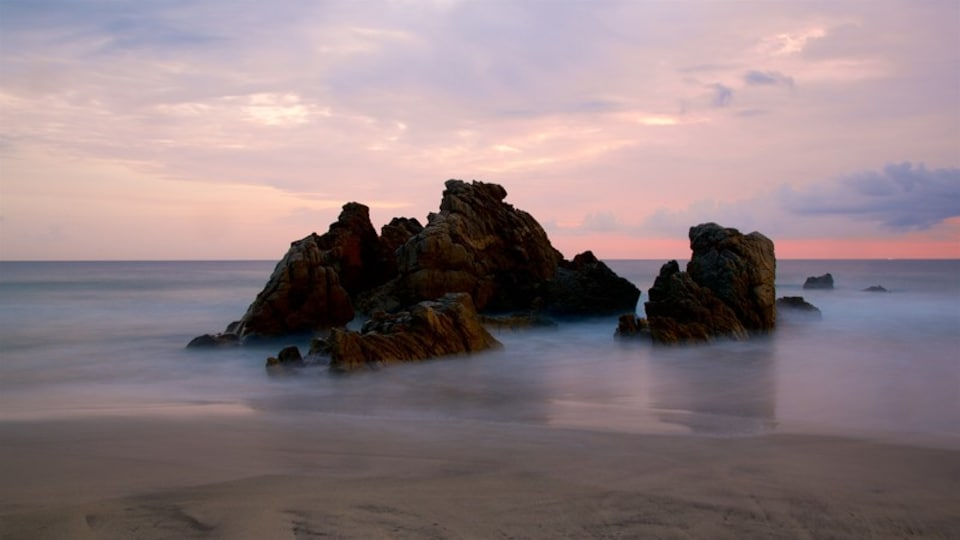 Zicatela Beach which includes a sunset, general coastal views and a sandy beach