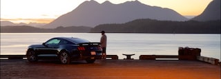 Tofino showing mountains, a lake or waterhole and a sunset