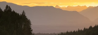 Port Alberni featuring a sunset, tranquil scenes and landscape views