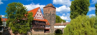 Maxbrucke which includes a bridge, a river or creek and heritage elements