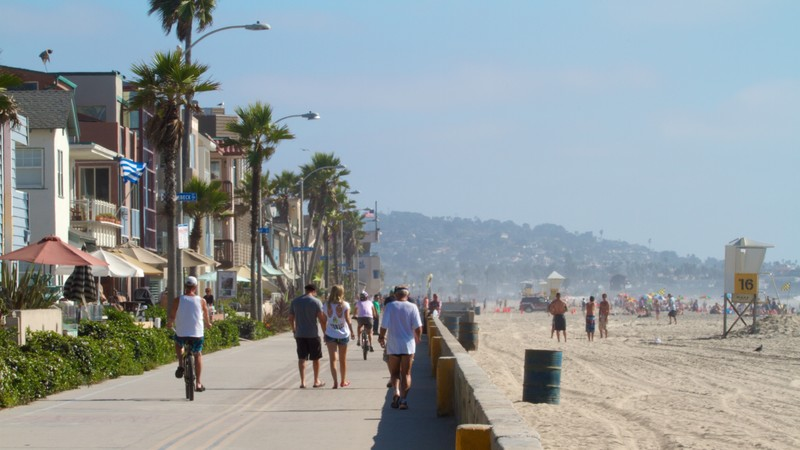 Mission Beach featuring street scenes, a beach and tropical scenes