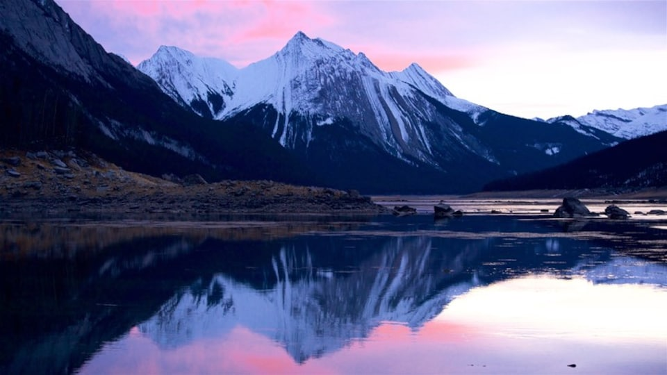 Medicine Lake which includes a sunset, a lake or waterhole and mountains