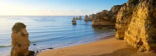 Dona Ana Beach featuring a sunset, a sandy beach and general coastal views