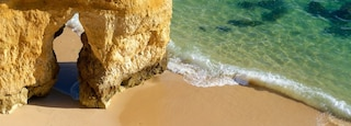 Camilo Beach showing general coastal views, a beach and rugged coastline