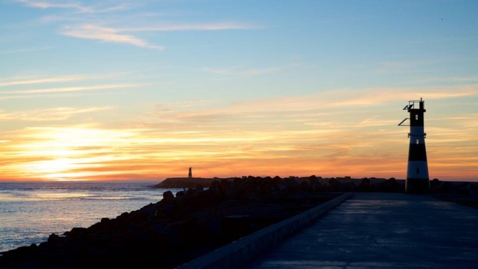 Barra Beach featuring a lighthouse, a sunset and general coastal views
