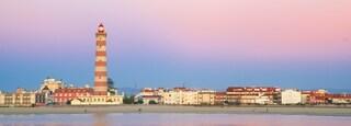 Barra Beach which includes a coastal town, general coastal views and a lighthouse