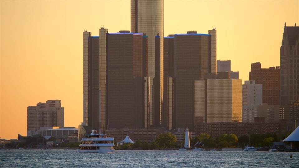 Belle Isle showing a sunset, a high rise building and a city