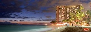 Waikiki Beach which includes general coastal views, a sandy beach and a coastal town
