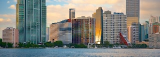 Rickenbacker Causeway Beach which includes a high rise building, a river or creek and a sunset