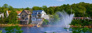 Canada which includes a lake or waterhole, a small town or village and a fountain