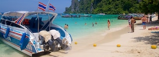 Ko Phi Phi featuring rugged coastline, a beach and swimming