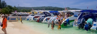 Ko Phi Phi which includes a beach, tropical scenes and boating