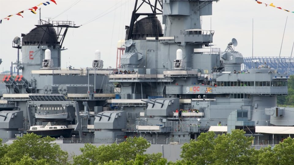 Battleship New Jersey featuring military items and a marina