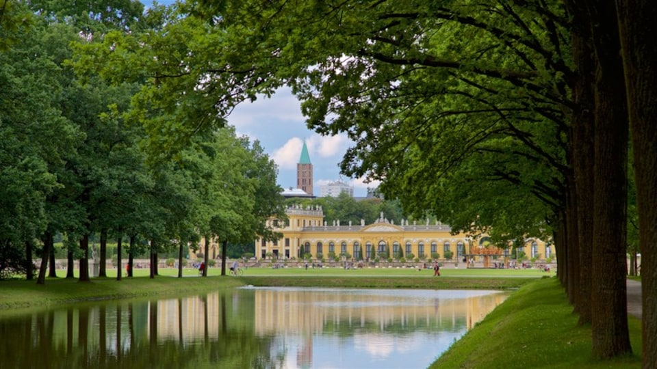 Karlsaue Park showing a river or creek, heritage architecture and a park