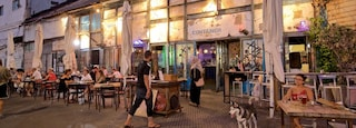 Jaffa Port featuring outdoor eating and night scenes as well as a small group of people