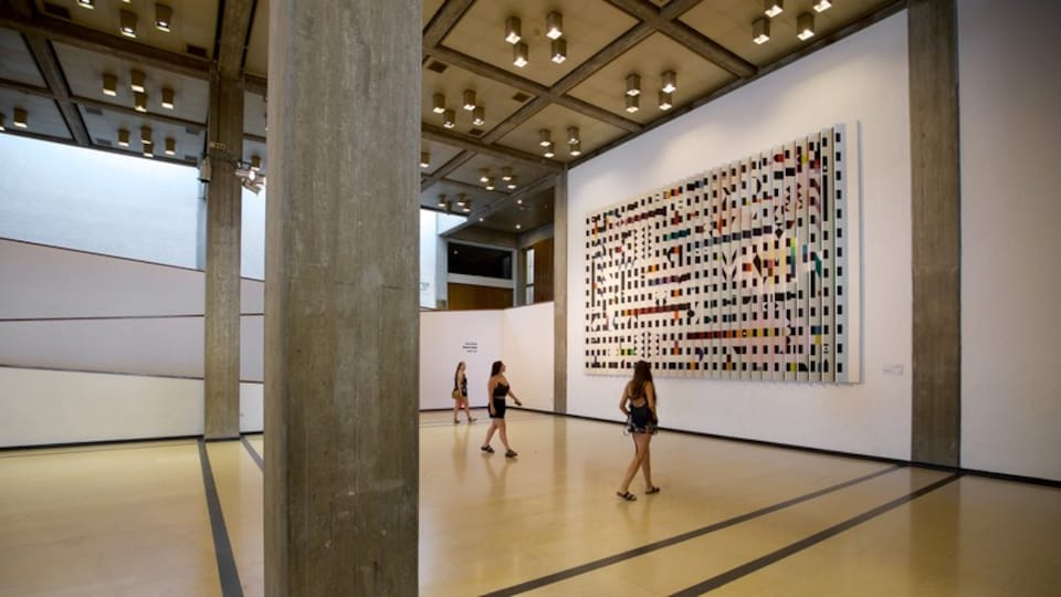 Tel Aviv Museum of Art showing interior views and art as well as a small group of people