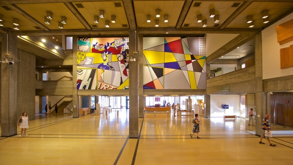 Tel Aviv Museum of Art featuring interior views and art as well as a small group of people