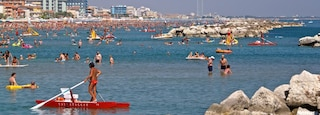Bellaria-Igea Marina which includes a coastal town, swimming and general coastal views