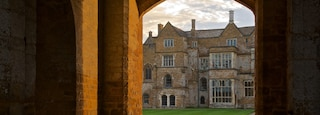 Broughton Castle featuring a house and heritage elements