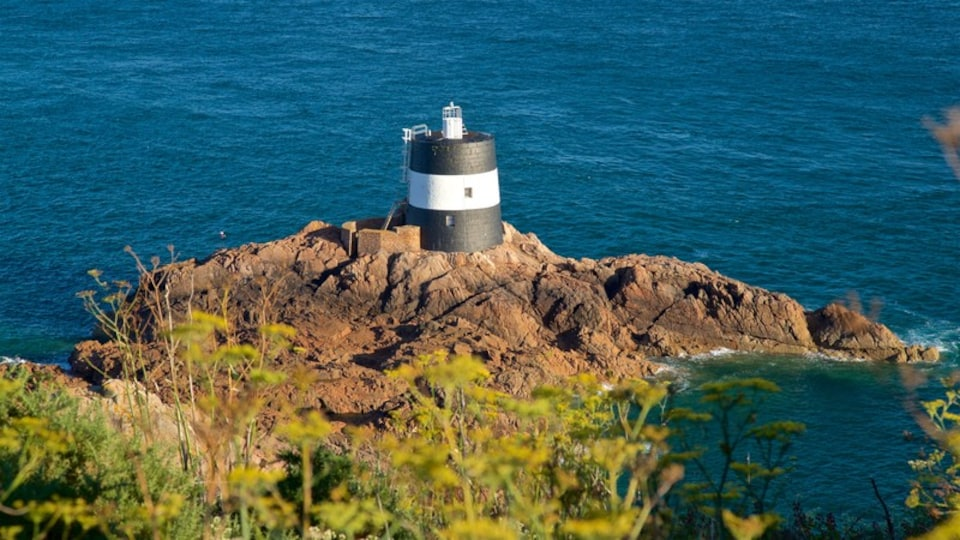 Jersey which includes rugged coastline, a lighthouse and general coastal views