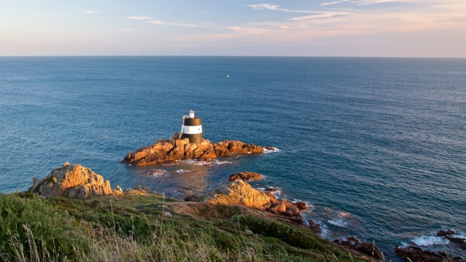 Jersey which includes a lighthouse, general coastal views and a sunset
