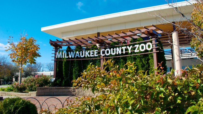 Milwaukee County Zoo featuring a garden, zoo animals and signage