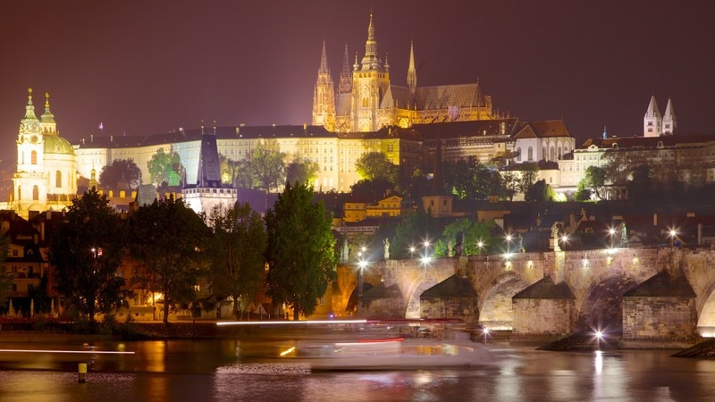 Prague Castle showing heritage architecture, a city and night scenes
