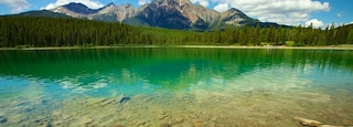 Patricia Lake which includes landscape views, mountains and a lake or waterhole