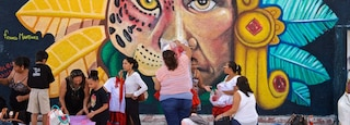 Isla Mujeres featuring outdoor art as well as a small group of people