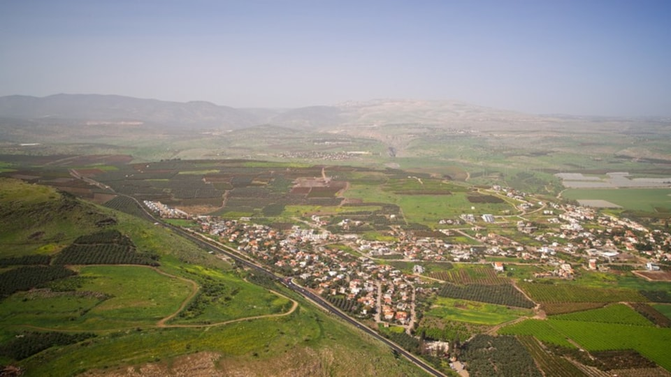 Mount Arbel which includes landscape views, tranquil scenes and a small town or village