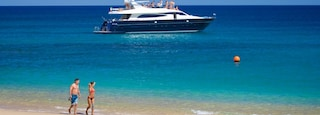 Chileno Beach which includes a sandy beach, boating and general coastal views