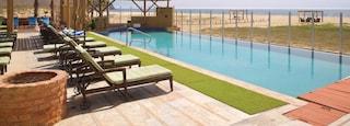 Todos Santos which includes general coastal views and a pool