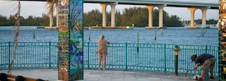 Royal Palm Pointe Park featuring a river or creek, a bridge and outdoor art