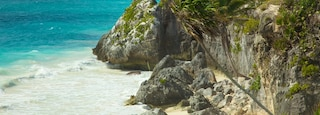 Tulum Mayan Ruins showing landscape views, rugged coastline and tropical scenes