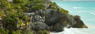 Tulum Mayan Ruins featuring rugged coastline and building ruins