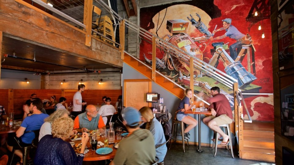 Portland which includes a bar and interior views as well as a small group of people