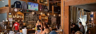 Portland which includes interior views and a bar as well as a small group of people