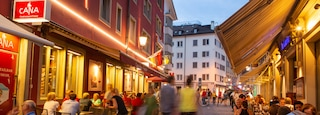 Old Town featuring night scenes and outdoor eating as well as a small group of people