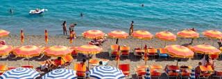 Maronti Beach which includes swimming, a sandy beach and general coastal views