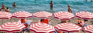 Maronti Beach featuring a sandy beach, swimming and general coastal views