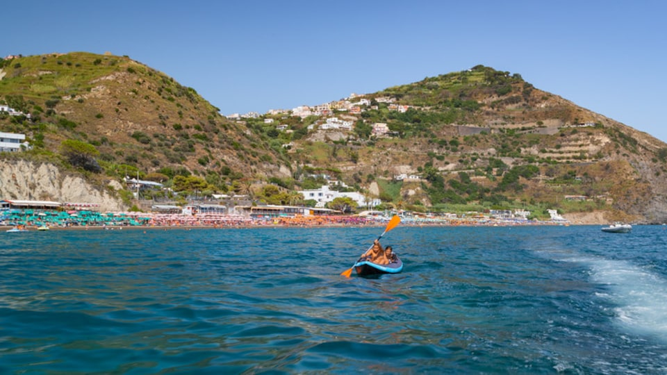Maronti Beach which includes kayaking or canoeing and general coastal views as well as a couple