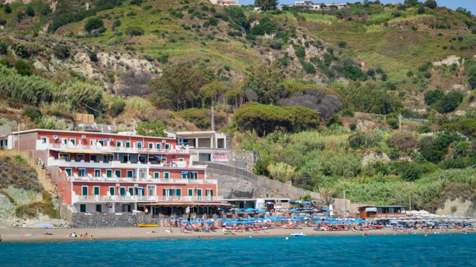 Maronti Beach which includes a sandy beach and a coastal town