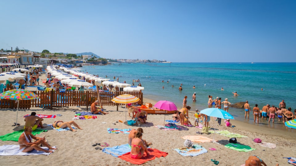 San Francesco Beach featuring swimming, general coastal views and a beach